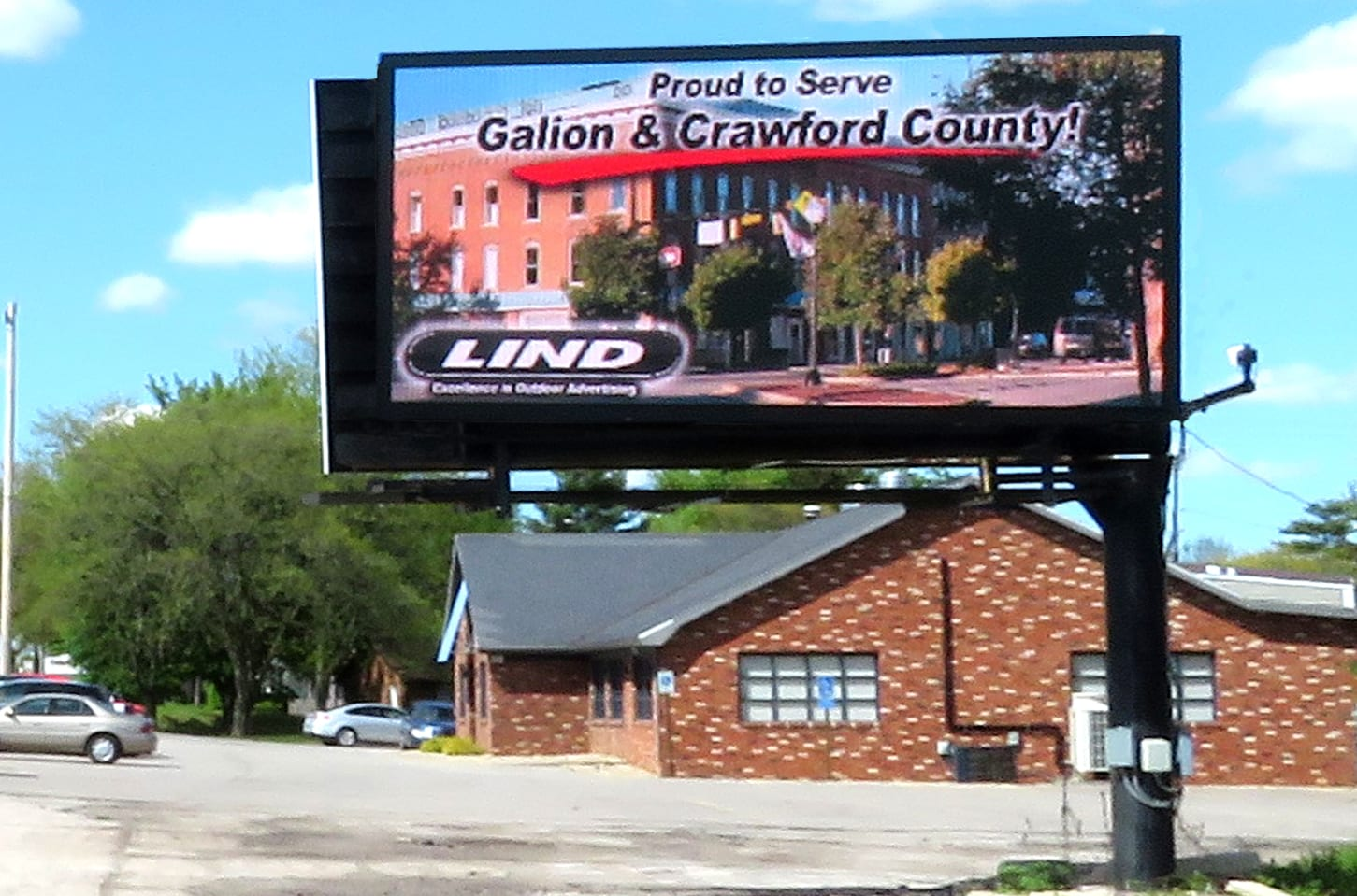 """An image of Lind's digital billboard in Galion. On the board, there is an image reading """"Proud to Serve Galion & Crawford County!"""""""
