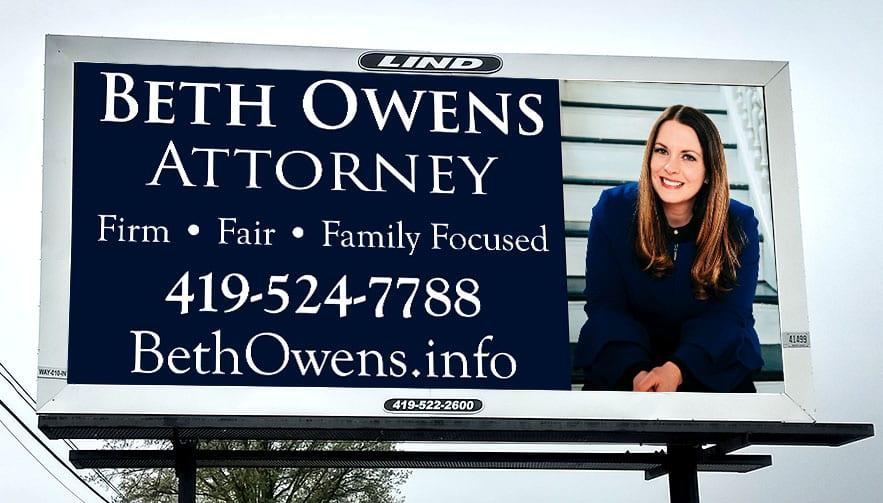 "An image of a billboard reading ""Beth Owens, Attorney."""